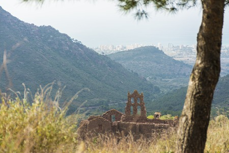 Ruins of the Carmelite convent of Benicassim, Castellon, Spain, with the town and beach at background