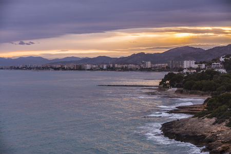 Benicassim town and beach from a hill at north, with nice colours at sunset, with zoom