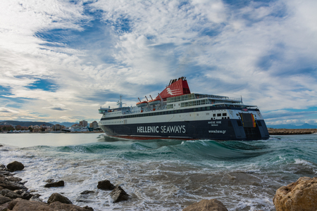 Denia, Alicante, Spain, november 21, 2018: Greek ferry along the breakwaters of the port and forming large waves while entering the harbor Standard-Bild - 121522958