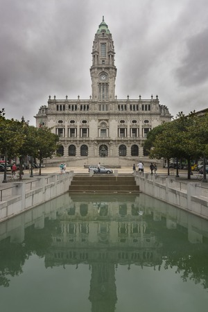 PORTO, PORTUGAL - JULY 19, 2017: City council. Work of the architect Antonio Correia da Silva. It was built between 1920 and 1957. It has a clock tower. The facade is made of granite stone