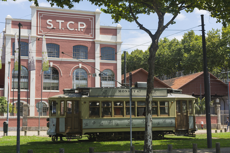 PORTO, PORTUGAL - JULY 20, 2017: Tourist tram stopped in front of the electric train museum. Line between the neighborhoods of Ribeira and Foz, runs along the banks of the river Douro Editorial
