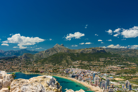 View of the area of apartments and hotels in Calpe, residential area and Aitana mountain range from the top of the rock of Ifach