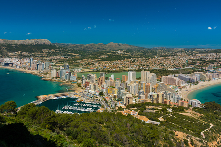 View of the area of apartments and hotels in Calpe, with the marina and the salt pans from the top of the rock of Ifach Foto de archivo