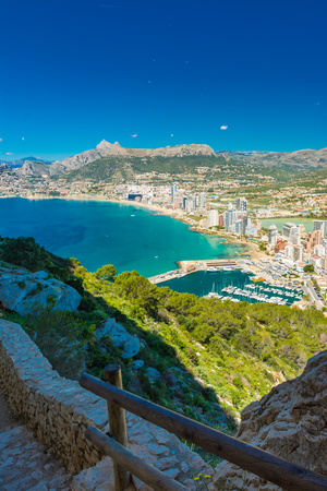 View of the area of apartments and hotels in Calpe, from the door of the tunnel, in the hiking to the top of the Ifach rock