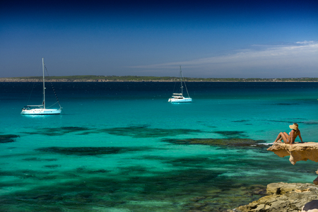 FORMENTERA, SPAIN - SEPTEMBER 12, 2017: Impressive Calo Des Mort cove, at southeast with a small cliff from where to contemplate the transparent waters of its coast Editorial