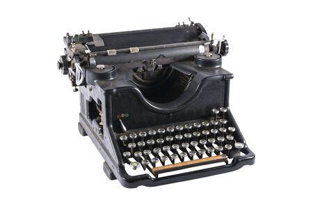 Old black typewriter isolated on white background