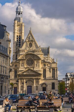 Paris, France - November 7, 2019: Students of The Sorbonne in front of the Saint-?? Tienne-du-Mont church. The Jacques Doucet Literary Library at the left side Éditoriale
