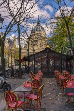 Paris, France - November 7, 2019: Typical french terrace bar in the square, in front of the chapel of the Sorbonne University.
