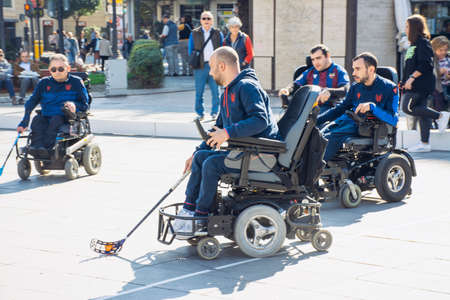 Valencia, Spain. February 15, 2020 - Adaptive sports day. Some adaptive hockey players playing in the town hall square