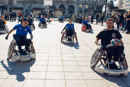 Valencia, Spain. February 15, 2020 - Adaptive sports day. Some adaptive quad rugby players playing in the town hall square