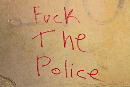 Fuck the police graffiti with red writing Stock Photo