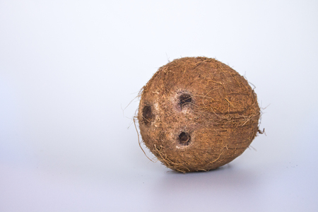 Coconut with smilie face isolated in horizontal on white background Stock Photo