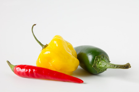 Yellow Habanero, red Rawit and green Jalapeno chili pepper isolated on white background