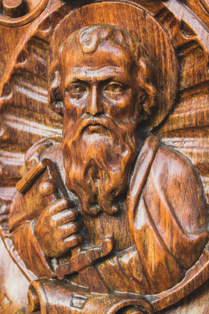 Wooden statue of St. Paul looking upwards
