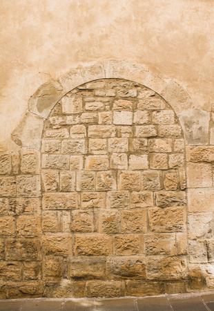 Ancient way close to a stone brick wall