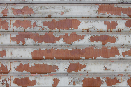 Detail of ruined and rusty rolling shutter grunge closed