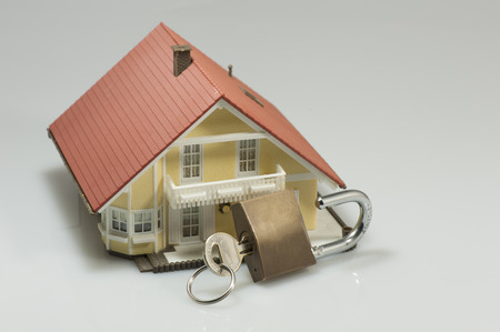padlock shut off: Model house with closed