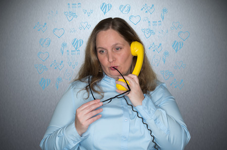 intellectually: Woman In Love with telephone Stock Photo