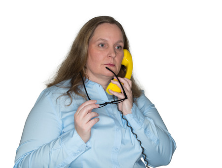 intellectually: Pensive and nervous woman on the telephone Stock Photo