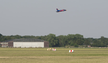 red bull: Germany - Schleswig Holstein, July 4, 2015: Wings Wheels open day with Red Bull Air Show, remote control jets - Uetersen Airport Holm 2015