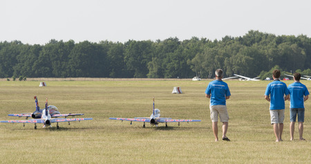 jets: Germany - Schleswig Holstein, July 4, 2015: Wings Wheels open day with Red Bull Air Show, remote control jets - Uetersen Airport Holm 2015