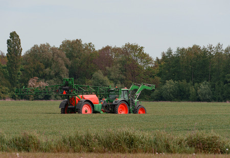agricultural engineering: Tractor with sprayer during application of pesticides