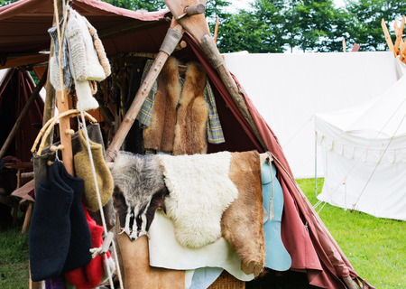 swordfight: Fur and wool stand on a medieval market Stock Photo