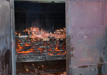 spanferkel: Suckling pig on a skewer for grilling