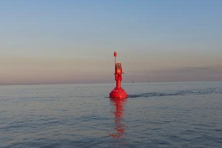 buoy: Orange buoy on the Elbe