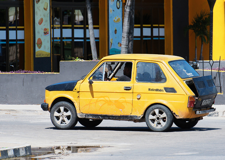 varadero: Yellow Classic Car dirves in Varadero City, Cuba
