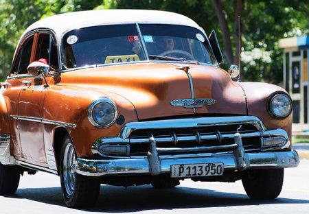 varadero: Orange American Classic Car dirves in Varadero City, Cuba