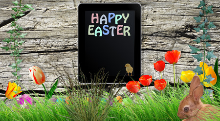 composing: Tablet on wooden board with Happy Easter