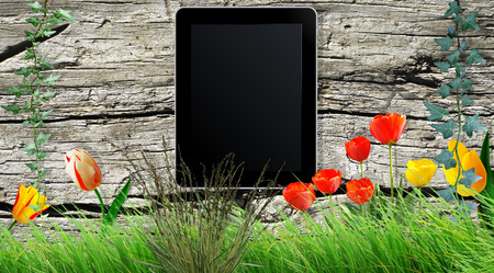 composing: Tablet on a wooden board as a background Stock Photo