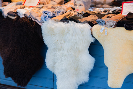 yule tide: fur accessories on a Christmas market Stock Photo