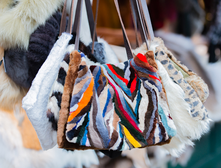 fur accessories on a Christmas market Stock Photo