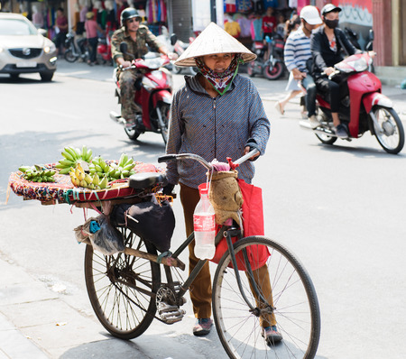 moulder: Vietnamese street vendors act and sell Their vegetables and fruit products in Hanoi, Vietnam