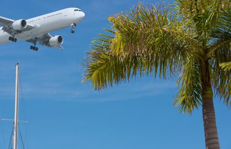 varadero: Landing approach of a plane across the beach on Cuba Varadero Stock Photo