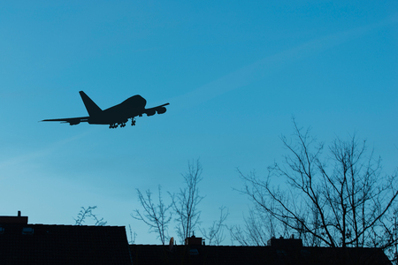 Airplane starts at night over residential area