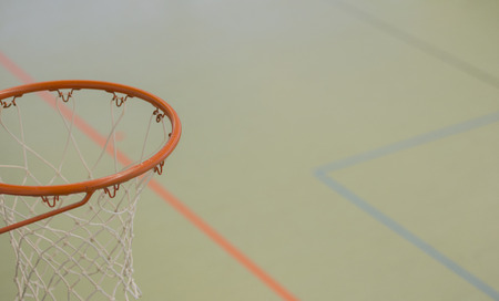 Basketball basket in a sports hall with various lines