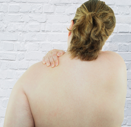 young woman has shoulder and back pain