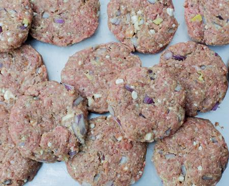 Prepared mincemeat for grilling hamburger on a plate Zdjęcie Seryjne