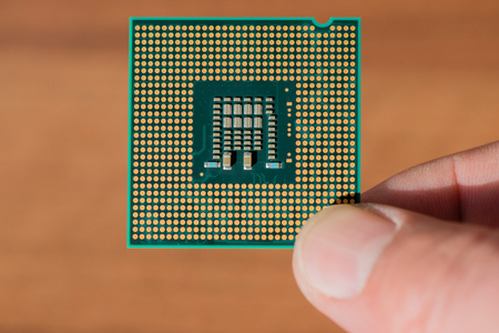 Computer CPU in closeup in front of wood background
