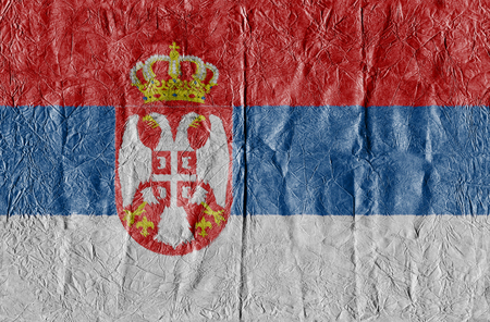 Serbia flag on a paper in close-up Stock Photo