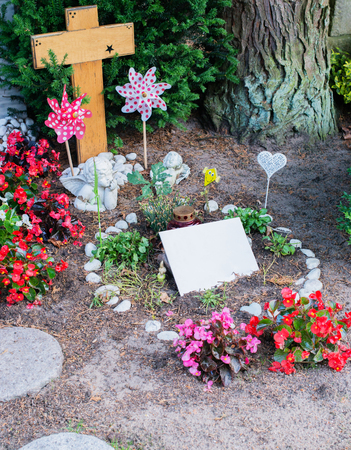 Flowers and grave in an old cemetery Stock Photo