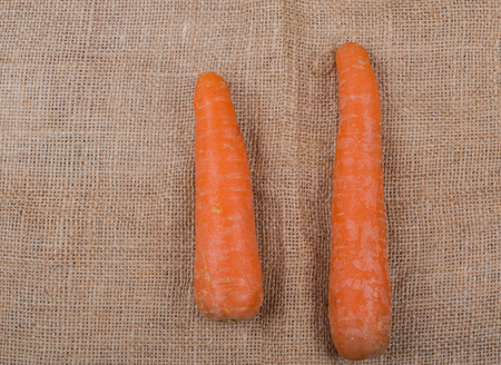 carrot root photographed on a jute fabric Stock Photo