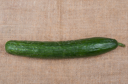 cucumber photographed on a jute fabric
