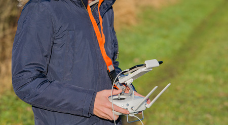 operates a remote control for a drone Stock Photo