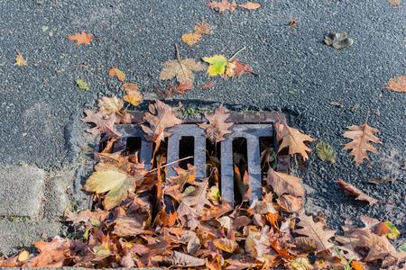 Clogged manhole cover on a street