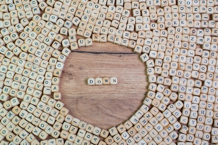 Down name in letters on cubes dices on table Imagens