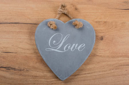 Wood background with slate heart as texture and background Stok Fotoğraf